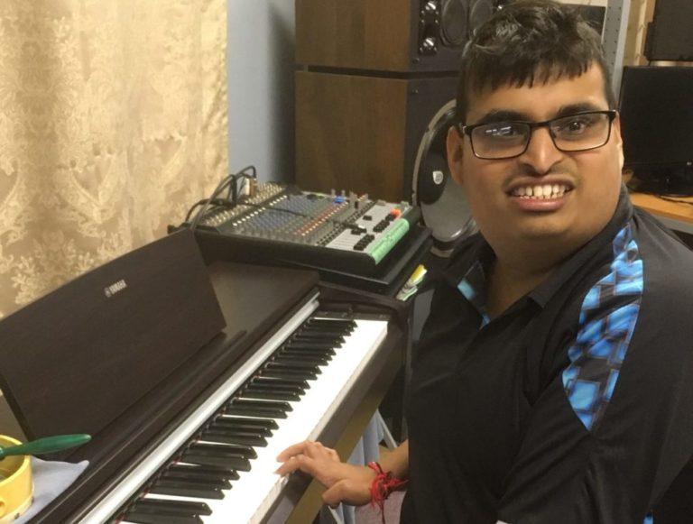 smiling at keyboard