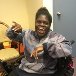 happy dancing girl in wheelchair